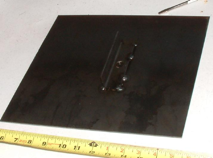 I simply welded a 1 steel angle to the bottom of it, to be held in vise.